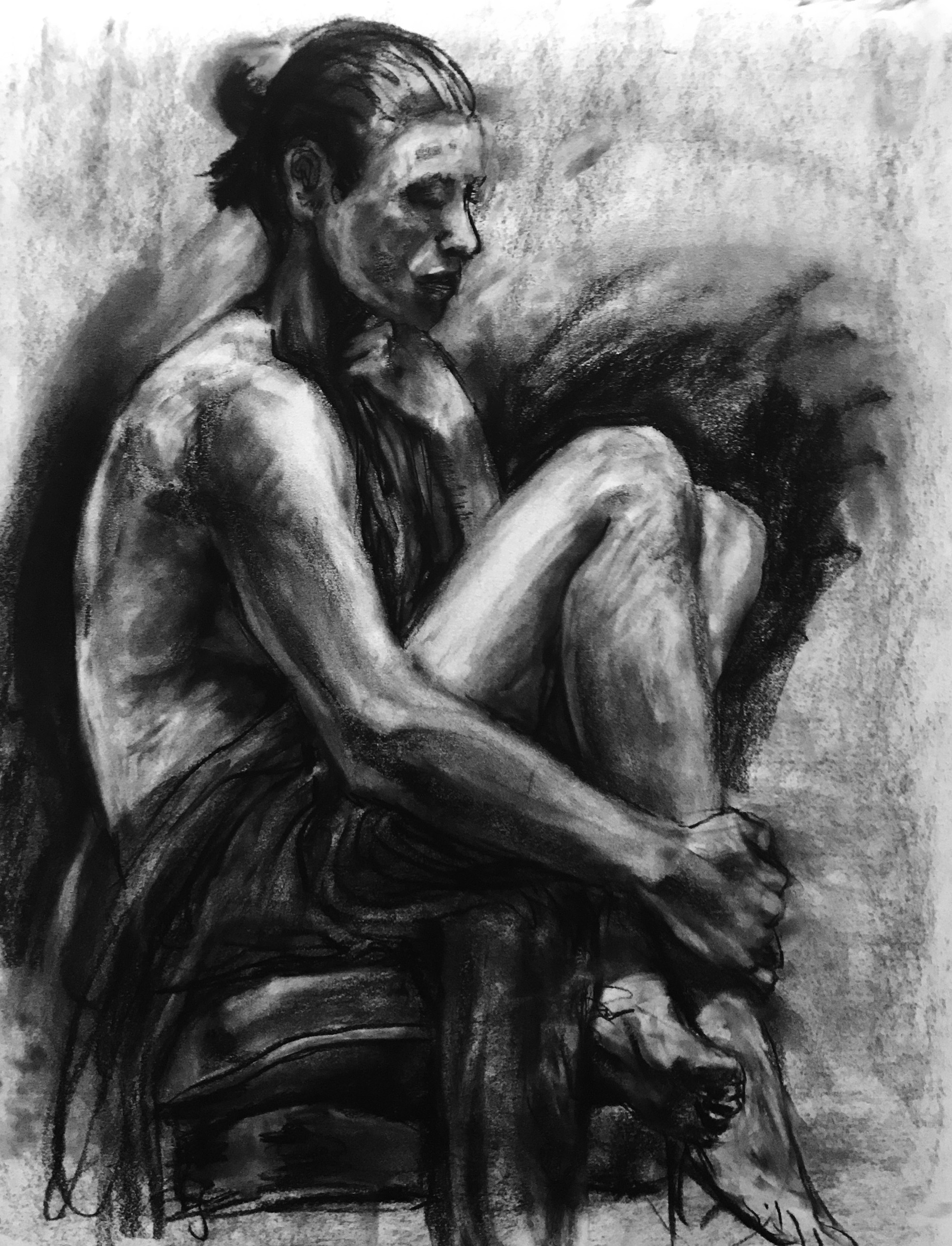 Charcoal sketch of woman.